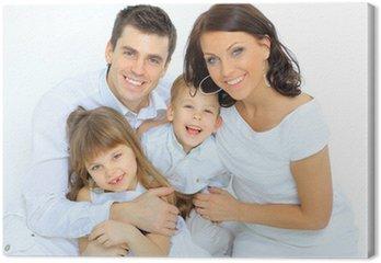 Canvastavla Porträtt av lycklig familj ler mot kameran