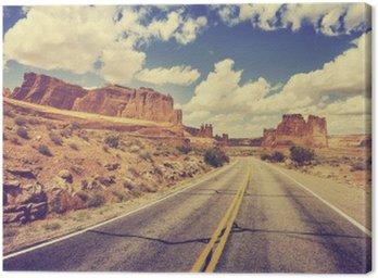 Canvastavla Retro stiliserad scen ökenväg, USA.