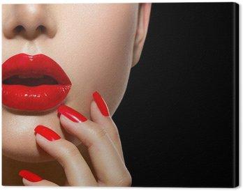 Canvastavla Röda sexiga läppar och naglar närbild. Manikyr och Makeup