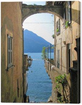 Canvastavla Romantisk tanke på den berömda italienska Comosjön från Varenna stad