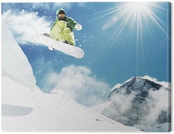 Canvastavla Snowboard vid hopp inhigh berg
