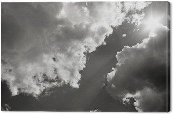 Canvastavla Solen bryter igenom molnen. Svartvitt foto
