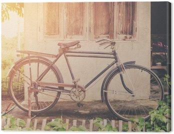 Canvastavla Tappning cykel eller gammal cykel tappning park på gamla muren hem.