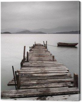 Canvastavla Tittar över en brygga och en båt, låg mättnad
