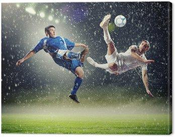 Canvastavla Två fotbollsspelare slog till på volley