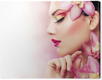 Canvastavla Vacker flicka med Orchid blommor. Perfect Make-up