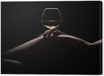 Canvastavla Vacker, naken kvinna kropp siluett och ett glas dryck