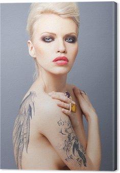 Canvastavla Vamp söker kvinna med tatuering vingar på ryggen