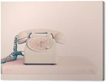 Canvastavla Vintage rosa telefon över böcker