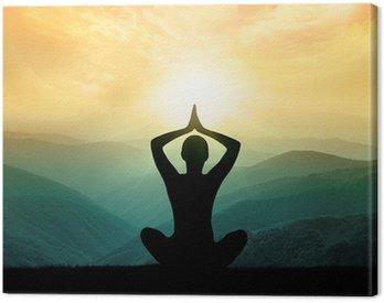 Canvastavla Yoga och meditation. Silhuetten av mannen i moontains.