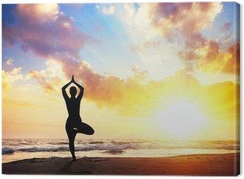 Canvastavla Yoga silhuett på stranden