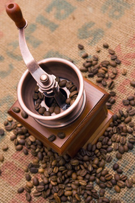 Coffee grinder among coffee beans