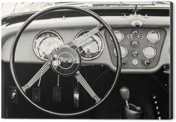 Cuadro en Dibond Volante y el salpicadero de un coche de época histórica