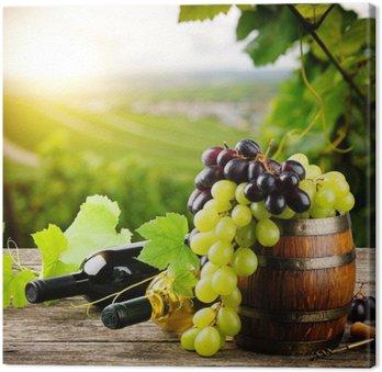 Cuadro en Lienzo Botellas de vino tinto y blanco con uva fresca