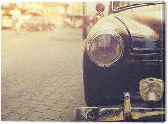 Cuadro en Lienzo Detalle de la lámpara del faro coche clásico estacionado en las zonas urbanas - estilo del efecto del filtro de la vendimia