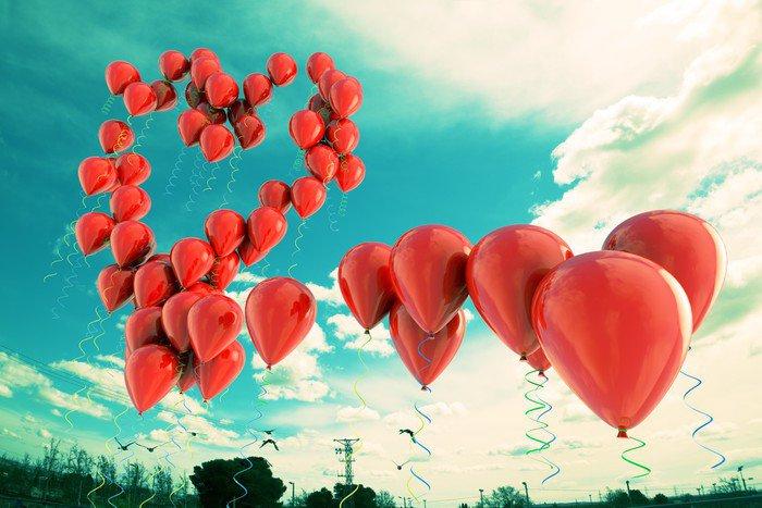 Cuadro en Lienzo Globos rojos formando una forma de corazón en el cielo - Felicidad