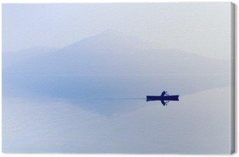 Cuadro en Lienzo Niebla sobre el lago. Silueta de montañas en el fondo. El hombre flota en un barco con una paleta.