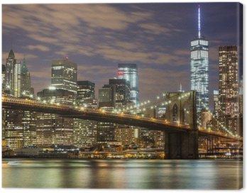 Cuadro en Lienzo Puente de Brooklyn y los rascacielos del centro de Nueva York en la oscuridad