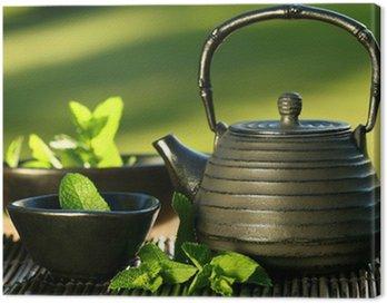 Cuadro en Lienzo Tetera de hierro negro asiático con ramitas de menta para el té