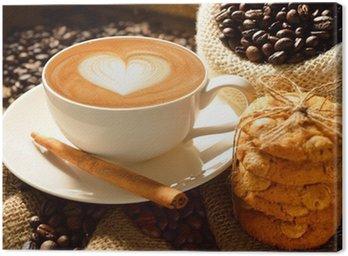 Cuadro en Lienzo Una taza de café con leche con los granos de café y galletas