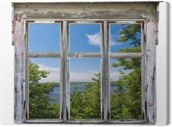 Cuadro en Lienzo Vista panorámica vista a través de un marco de ventana de edad