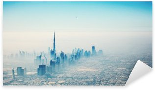 Pixerstick till Allt Dubai stad i soluppgången Flygfoto
