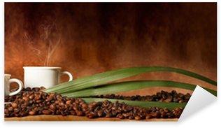 Pixerstick till Allt Kaffekopp med kaffebönor utspridda på bordet
