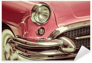 Pixerstick Dekor Retro stil bild av en framför en klassisk bil