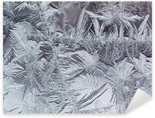 Pixerstick Dekor Vacker vinterdag frostiga mönster gjorda av spröda genomskinliga kristaller på glaset