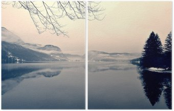 Diptych Snowy winter landscape on the lake in black and white. Monochrome image filtered in retro, vintage style with soft focus, red filter and some noise; nostalgic concept of winter. Lake Bohinj, Slovenia.
