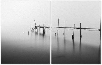Diptyk En lång exponering av en förstörd Pier i mitten av den Sea.Processed i B