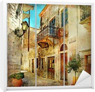 Dolap Çıkartması Yunanistan'ın resimsel eski sokakları
