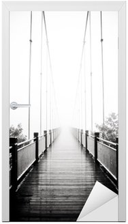 Door Sticker view on pedestrian wooden bridge in mist