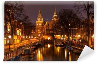 Vinyl Fotobehang Amsterdam in de avond. Bekijk in het Rijksmuseum