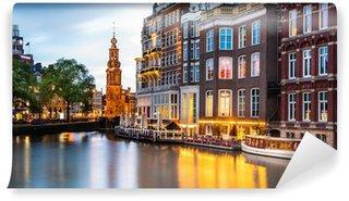 Vinyl Fotobehang Amsterdam stadsgezicht met de Munt toren in de schemering