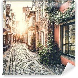 Vinyl Fotobehang Historische straat in Europa bij zonsondergang met retro vintage effect