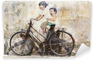"""Vinyl Fotobehang """"Kleine kinderen op een Fiets"""" Mural."""