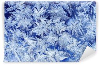 Vinyl Fotobehang Mooie feestelijke ijzige patroon met witte sneeuwvlokken op een blauwe achtergrond op glas