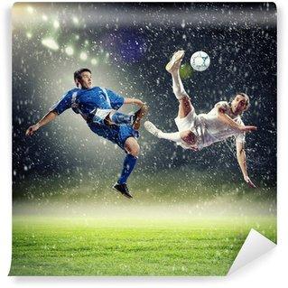 Vinyl Fotobehang Twee voetballers het slaan van de bal