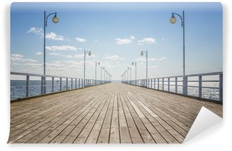 Fotomural de Vinil Old empty wooden pier over the sea shore with copy space