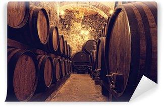Fotomural Estándar Barriles de madera con el vino en una bodega, Italia