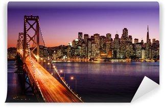 Fotomural Estándar Horizonte de San Francisco y el puente de la bahía al atardecer, California