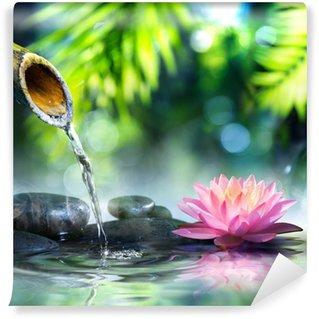 Fotomural Estándar Jardín zen con piedras negro y rosa waterlily