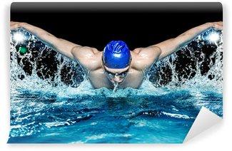 Fotomural Estándar Muscular joven en la tapa azul en la piscina