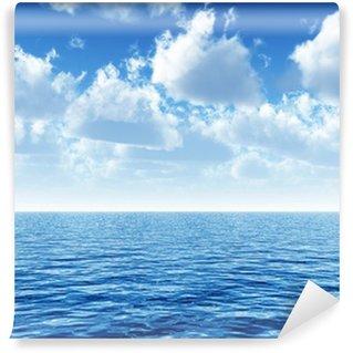 Vinyl-Fototapete Bewölkten blauen Himmel über einem blauen Oberfläche des Meeres