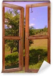 Vinyl-Fototapete Landschaft durch ein Fenster gesehen