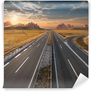 Vinyl-Fototapete Leere Autobahn bei Sonnenaufgang