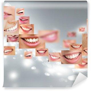 Fototapet av Vinyl Ansikten av leende människor i set. Friska tänder. Le