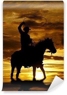 Fototapet av Vinyl Cowboy svängande rep på häst i vatten