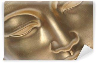 Fototapet av Vinyl Diagonal närbild av gyllene buddha ansikte.